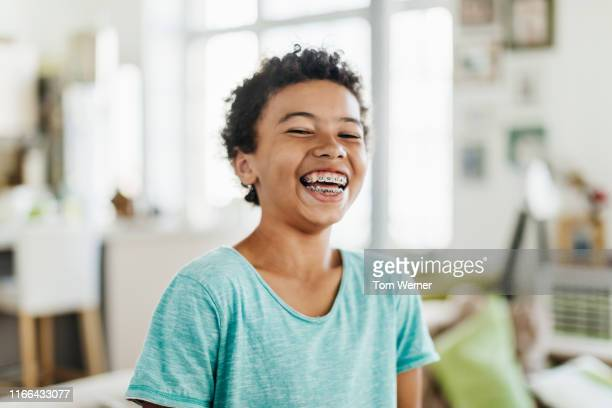 portrait of young boy smiling - brace stock pictures, royalty-free photos & images