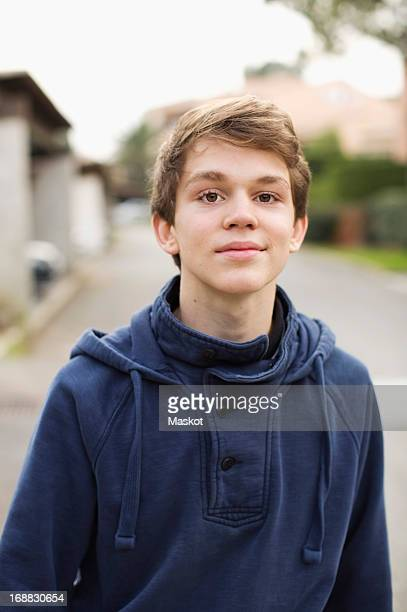 Portrait of young boy standing on street