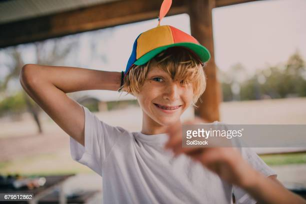 Portrait of Young Boy Wearing a Propeller Hat