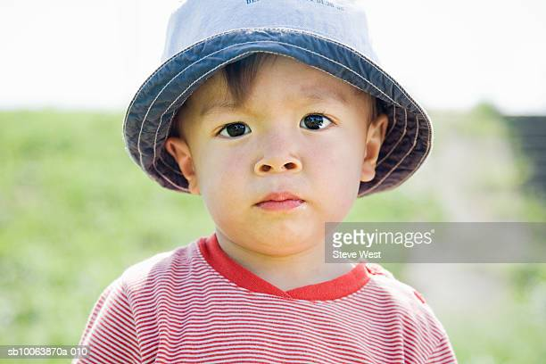 Portrait of young boy (2-3) wearing hat