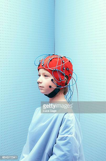 Portrait of young boy with brain test cap