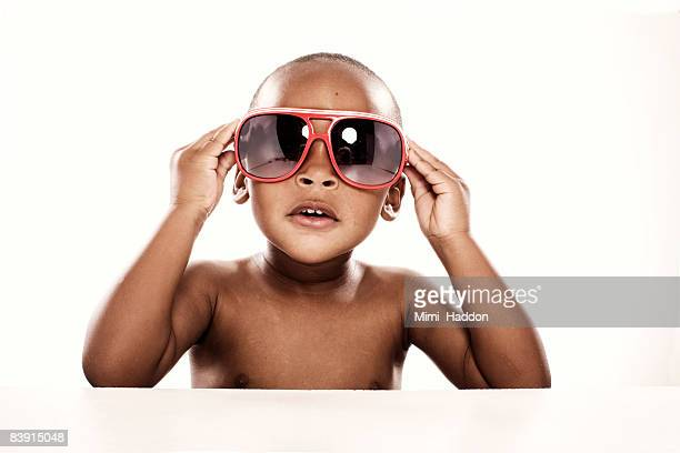 portrait of young boy with sunglasses