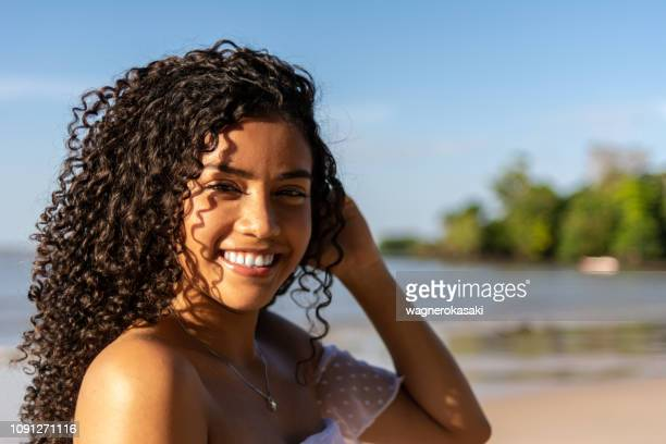 portrait of young brazilian woman on the beach. paraiso beach, mosqueiro - para state stock pictures, royalty-free photos & images
