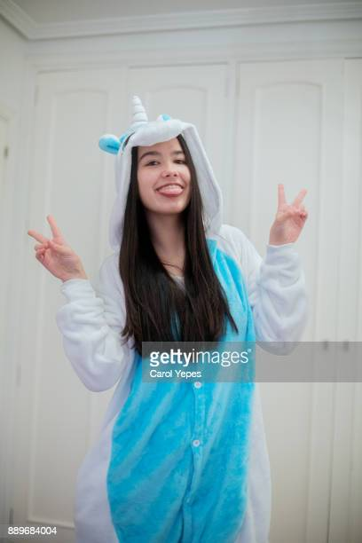 portrait of young brunette in unicorn  hooded onesie - infant bodysuit stock pictures, royalty-free photos & images