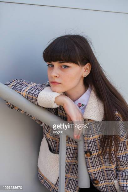 portrait of young brunette woman with bangs - bangs hair stock pictures, royalty-free photos & images