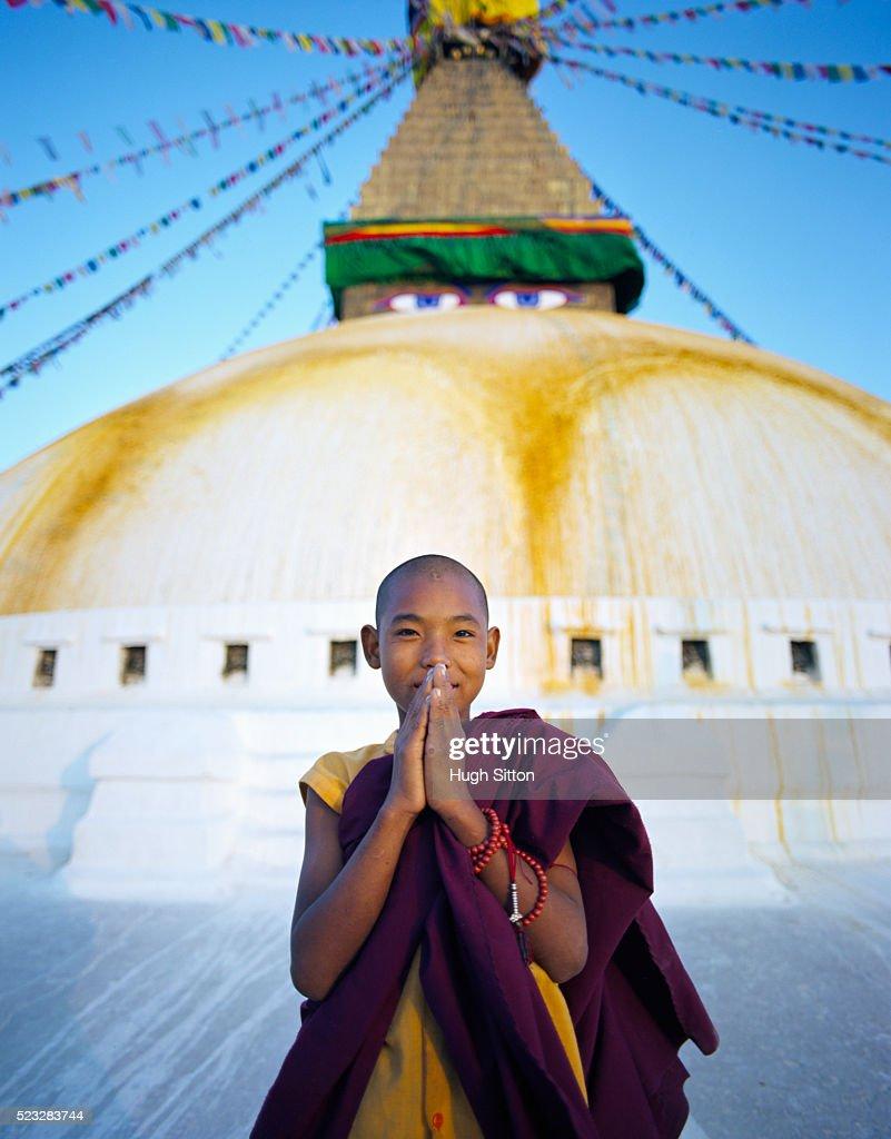 Portrait of young Buddhist monk at Boudhanath stupa in Kathmandu : Stock Photo