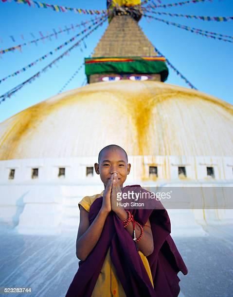 Portrait of young Buddhist monk at Boudhanath stupa in Kathmandu