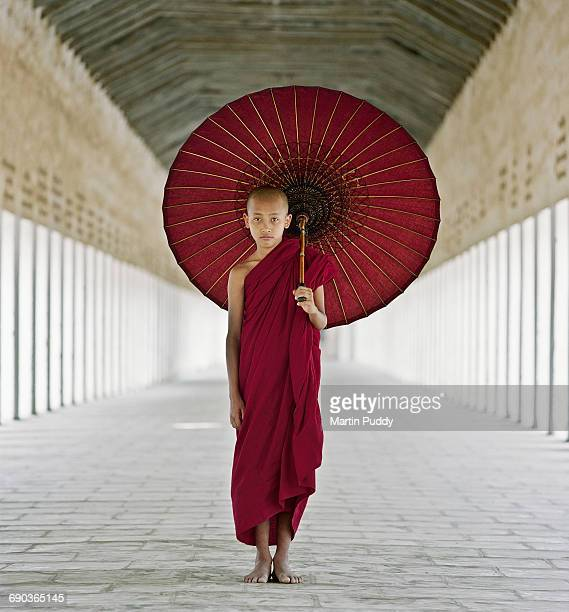 portrait of young buddhist monk - angkor stock photos and pictures
