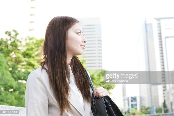 Portrait of young business woman in city location