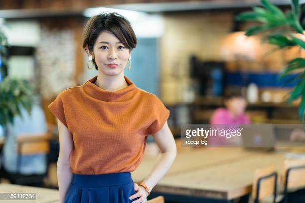 portrait of young business woman in modenr co-working space - japan stock pictures, royalty-free photos & images