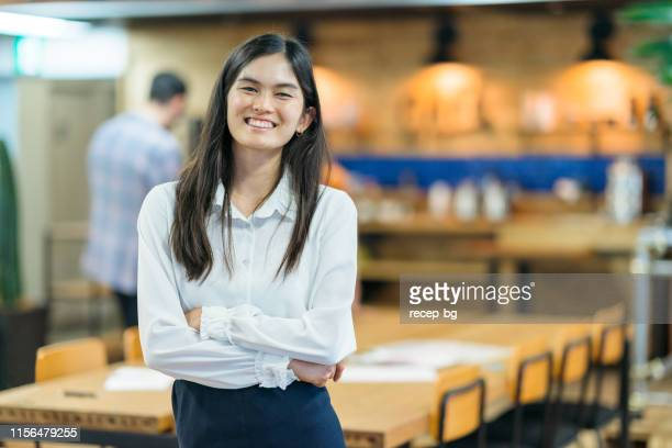 portrait of young business woman in modenr co-working space - filipino ethnicity and female not male stock pictures, royalty-free photos & images