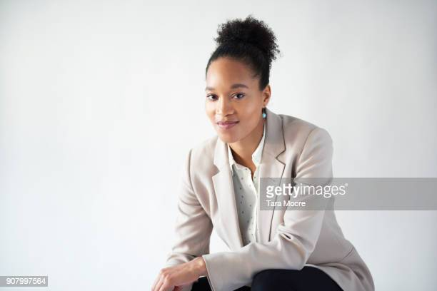 portrait of young business woman - hair back stock pictures, royalty-free photos & images