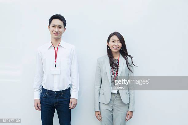 Portrait of young businessman and woman, smiling