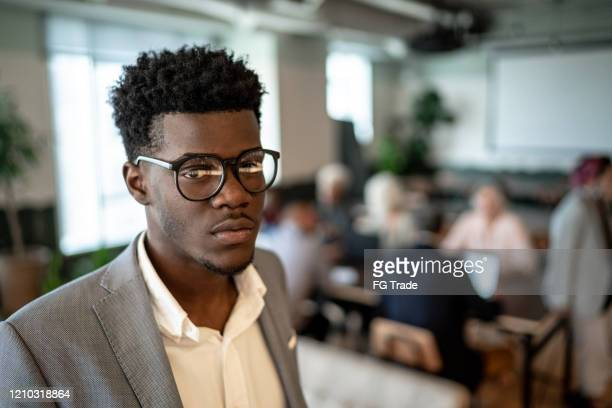 portrait of young businessman at office - businesswear stock pictures, royalty-free photos & images