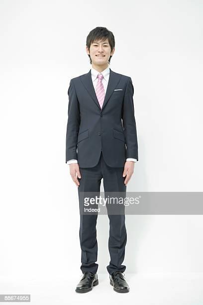 portrait of young businessman, full length - 全身 ストックフォトと画像