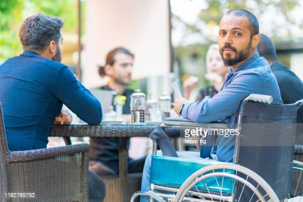 portrait of young businessman in wheelchair - persons with disabilities stock pictures, royalty-free photos & images