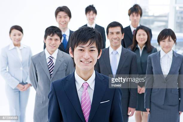 Portrait of young businessman, partners in behind