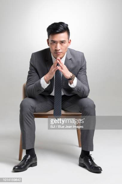 portrait of young businessman - one man only stock pictures, royalty-free photos & images