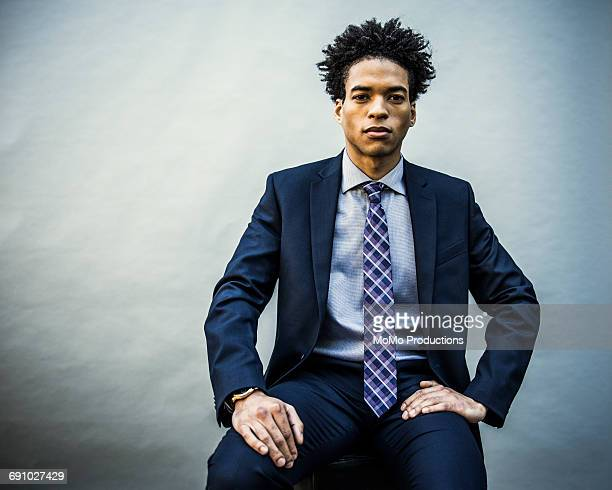 portrait of young businessman - checked suit stock pictures, royalty-free photos & images