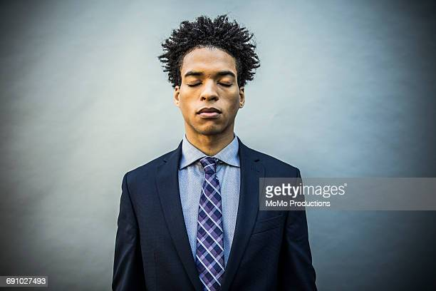 portrait of young businessman - eyes closed stock pictures, royalty-free photos & images