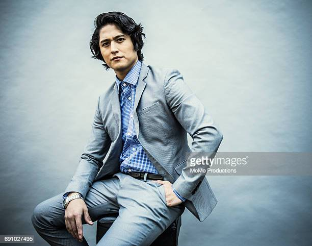 portrait of young businessman - gray suit stock pictures, royalty-free photos & images