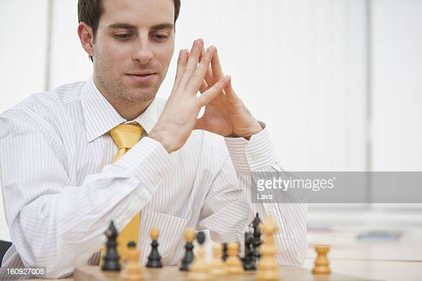 portrait of young businessman playing chess