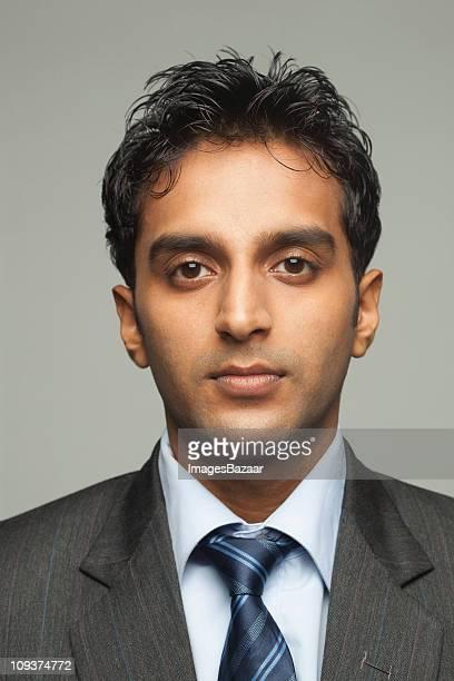 Portrait of young businessman, studio shot