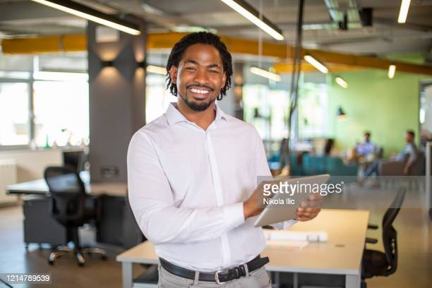 portrait of young businessman with modern technology. - white shirt stock pictures, royalty-free photos & images