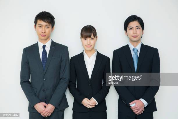 portrait of young businessmen and woman - 隣り合う ストックフォトと画像
