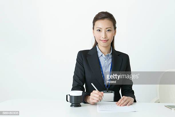 Portrait of young businesswoman at table