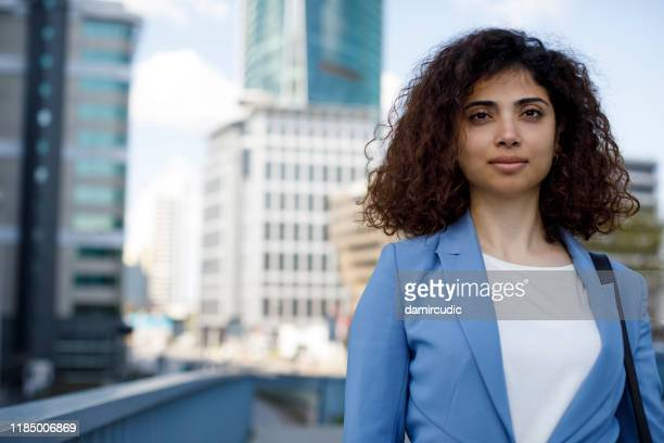 portrait of young businesswoman communting to work - contemporary istanbul foto e immagini stock