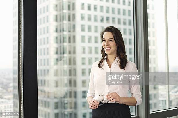 Portrait of young businesswoman in high rise office
