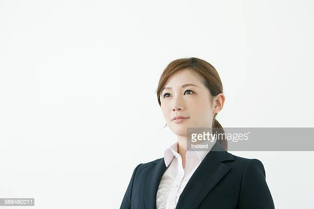 portrait of young businesswoman looking away - 20代 ストックフォトと画像