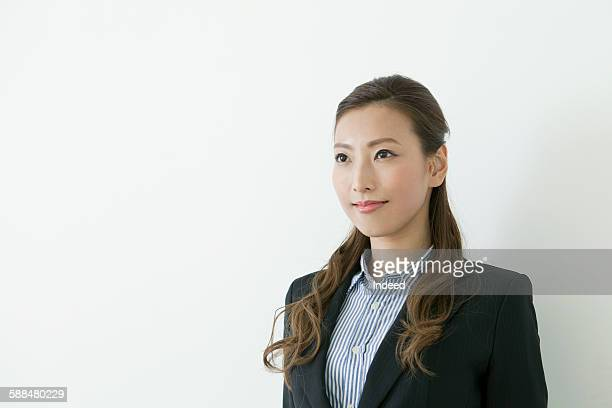 Portrait of young businesswoman looking away