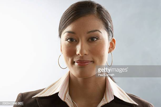 portrait of young businesswoman - hoop earring stock pictures, royalty-free photos & images