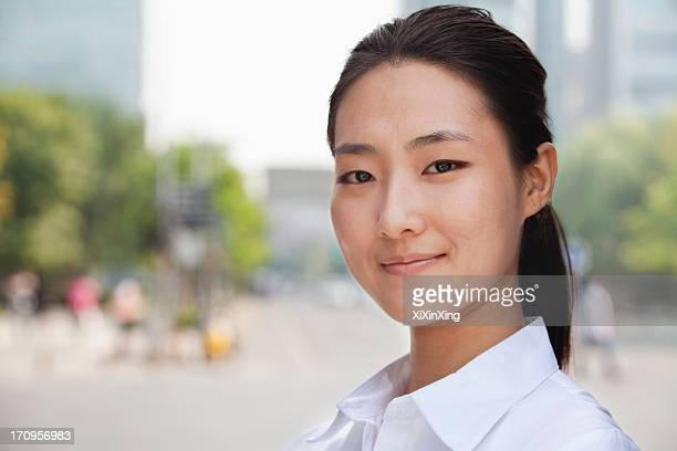 Portrait of young businesswoman smiling outside in Beijing