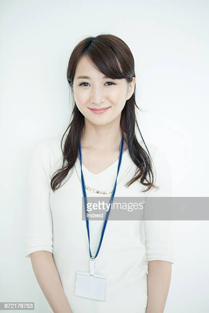 Portrait of young businesswoman, smiling