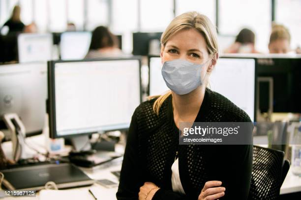 portrait of young businesswoman wearing healthcare mask. - white collar worker stock pictures, royalty-free photos & images
