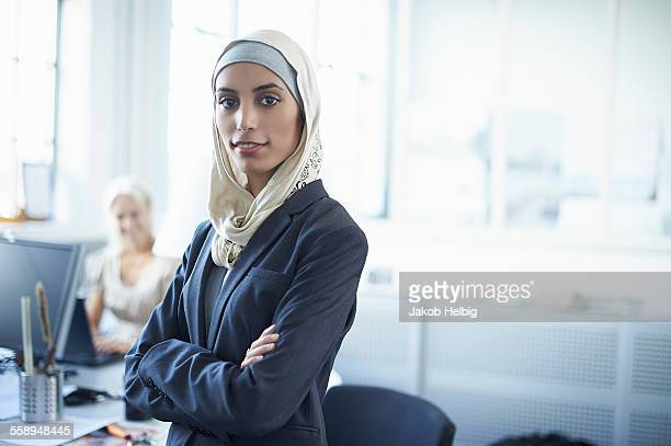 portrait of young businesswoman wearing hijab in office - traditional clothing stock pictures, royalty-free photos & images