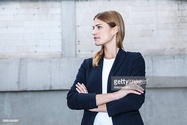 Portrait of young businesswoman with crossed arms