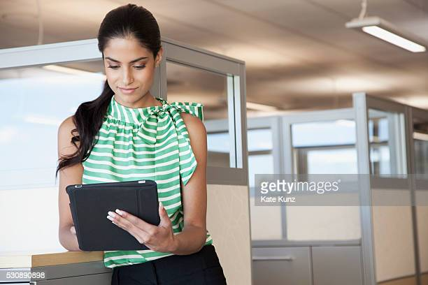 Portrait of young businesswoman working in office cubicle
