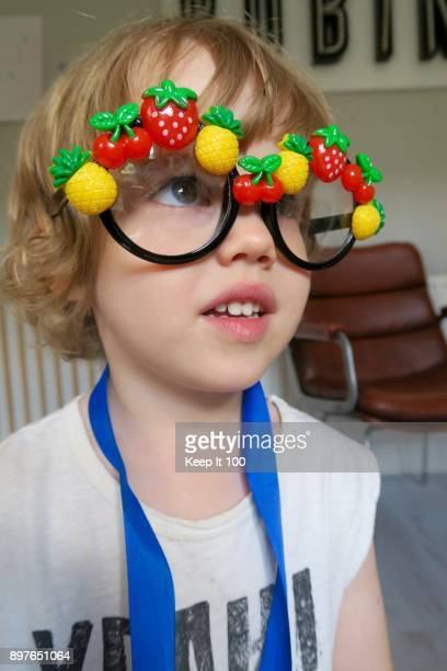 Portrait of young child wearing novelty glasses