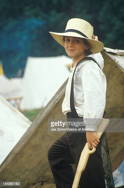 Portrait of young Civil War participant in camp scene during recreation of Battle of Manassas Virginia
