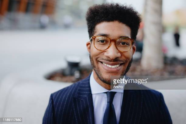 portrait of young confident businessman - financial analyst stock pictures, royalty-free photos & images