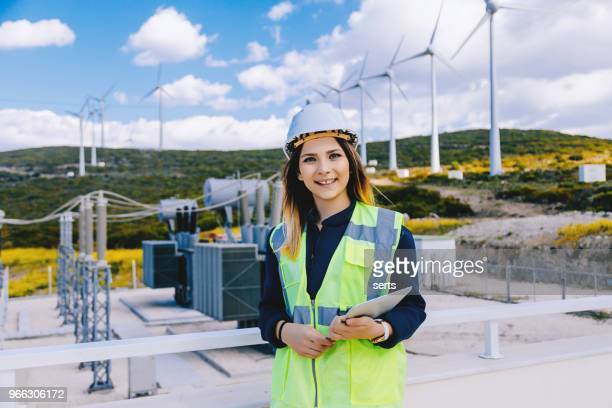 Portrait of young confident female engineer in electric power station