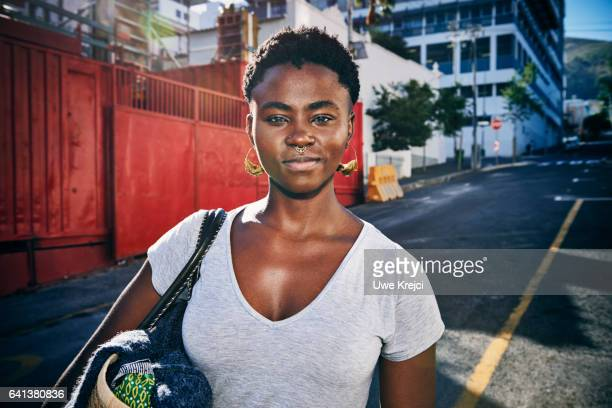 portrait of young confident woman in the city - short hair stock pictures, royalty-free photos & images
