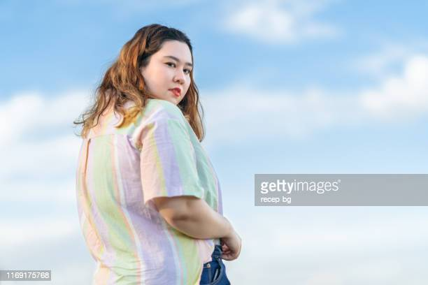 portrait of young confident woman - plus size model stock pictures, royalty-free photos & images