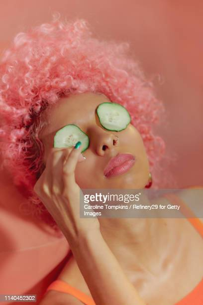 portrait of young confident women with cucumbers on eyes - noapologiescollection stock pictures, royalty-free photos & images