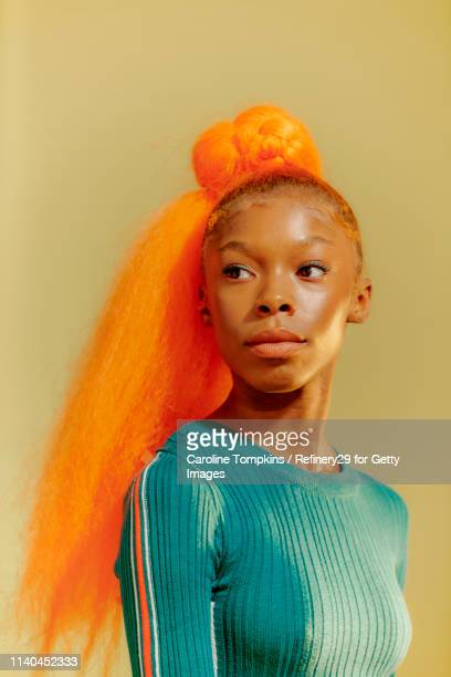 Portrait Of Young Confident Women With Orange Hair