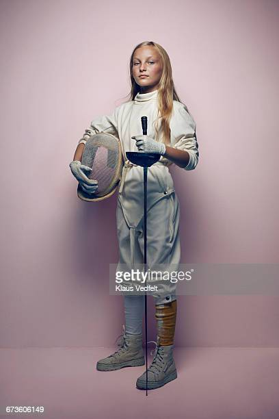 Portrait of young cool fencing girl